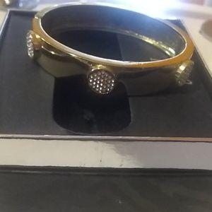 INC gold hinged bangle with sparkles